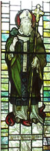Stained glass window showing our patron saint St Patrick. This was in the old church and can now be seen in the Blessed Sacrament Chapel.